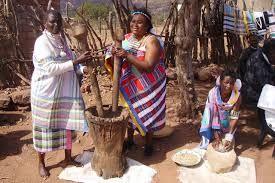 Venda women making grain meal