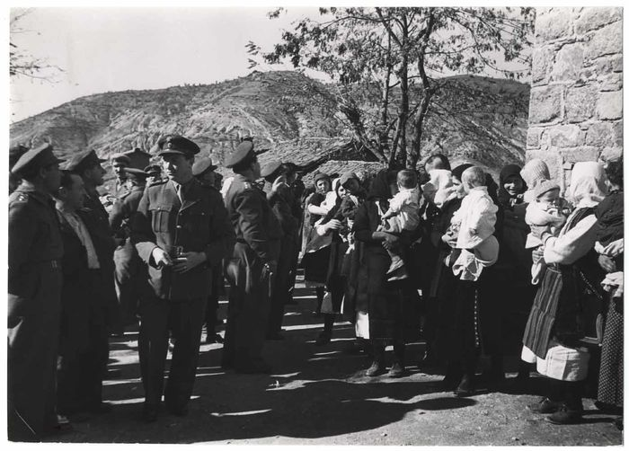 [Officers of the Greek army, and mothers with babies waiting outside a church, Andartikon, Greece] 1950. CHIM (DAVID SEYMOUR)0.