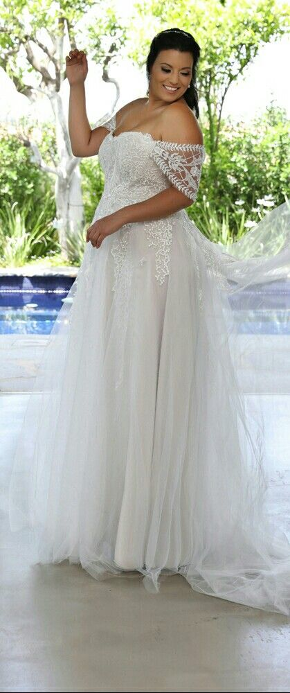 Stunning plus size tulle wedding gown with off shoulder sleeves. Kerrie. Studio Levana