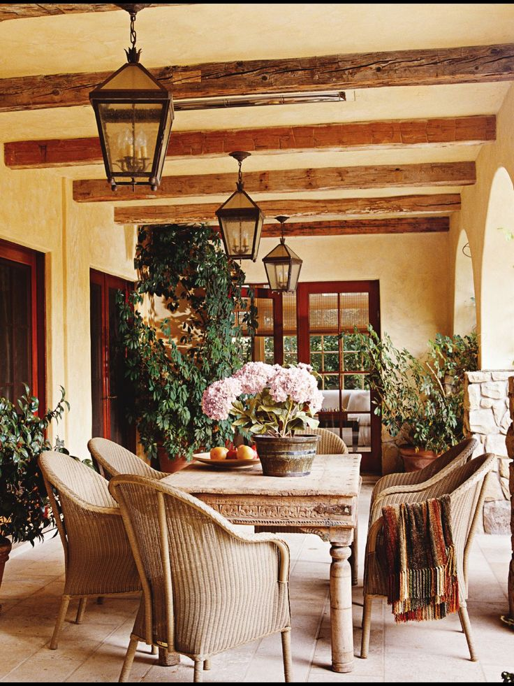 Sunny Warm Stucco Color Antique Table And Rustic Lighting Give The Porch Ambience LOVE The