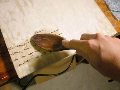 Lisa Kairos: Open Studio  http://lisakairos.wordpress.com/2008/12/29/encaustic-technique-3-collage-and-enclosures/