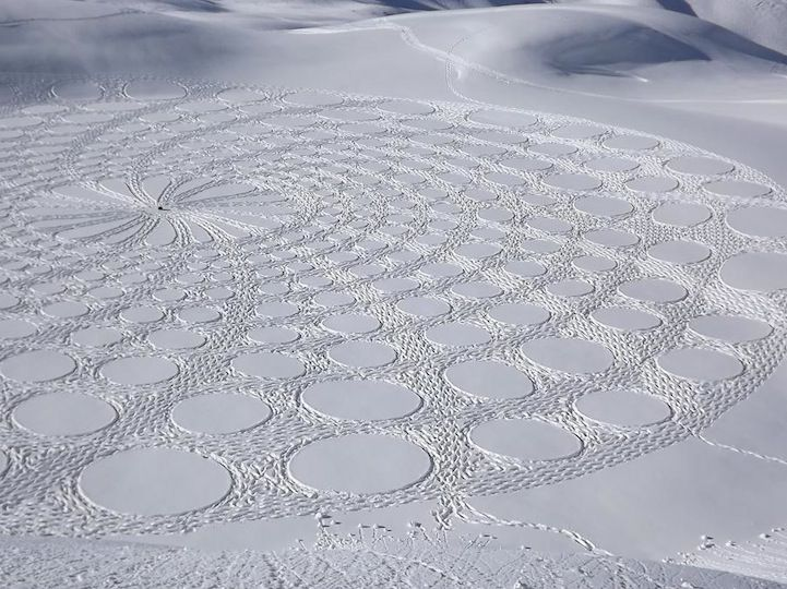 Simon Beck / Along the frozen lakes of Savoie, France, he spends days plodding through the snow in raquettes (snowshoes), creating these sensational patterns of snow art. Working for 5-9 hours a day, each final piece is typically the size of three soccer fields! The geometric forms range in mathematical patterns and shapes that create stunning, sometimes 3D, designs when viewed from higher levels. / (someone let me know if this is fake?)
