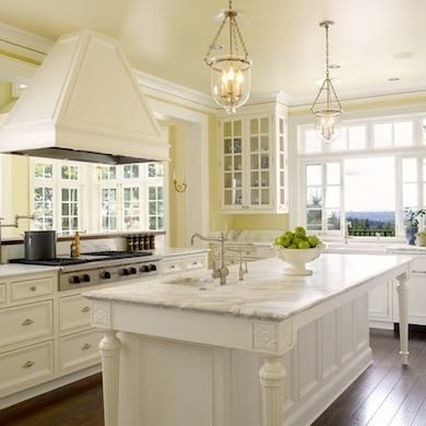 Kitchen Paint Colors: 10 Handsome Hues for Hardworking Spaces - Pale Yellow Walls, Glass front cabinetry, antique white paint for lower cabinets