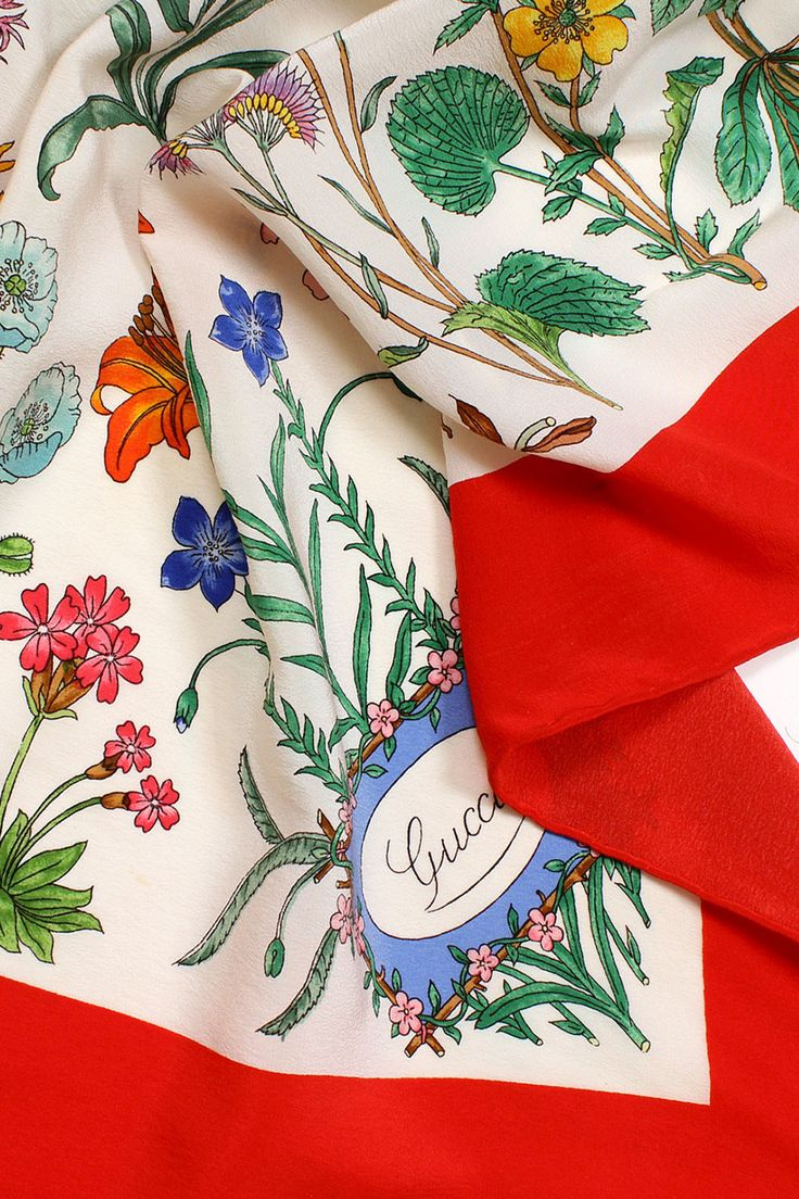 Gorgeous and eye catching red trimmed 80s Gucci botanical print silk scarf.