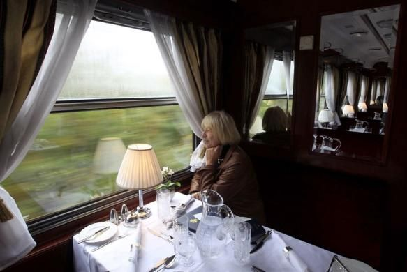 A passenger looks out of the window of the restaurant car of a historic Tehran-bound train as it leaves Budapest October 15, 2014. REUTERS/Bernadett Szabo visit http://iranpocketguide.com #Iran #Persia #Tehran #Budapest #TravelToIran #MyIran #Travel2Budapest #MyBudapest