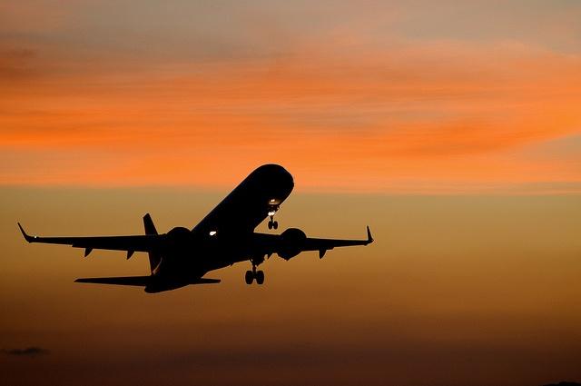 Embraer jet at sunset