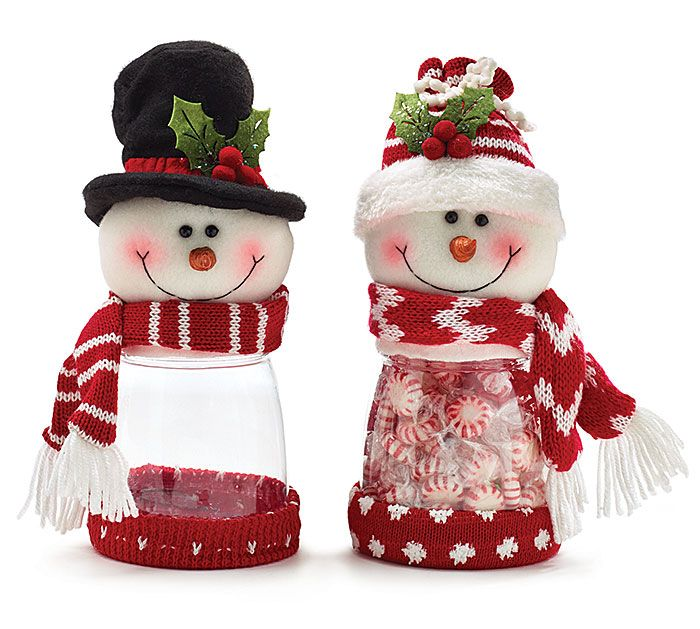 """#burtonandburton Snowman plush with acrylic candy holders. One snowman with black top hat and red/white striped scarf. One snowman with red knit hat and red/white chevron scarf. Red fabric on the bottom of both.<br><br>11""""H X 4 1/2""""W X 4 1/2""""D X 3""""Opening<br>2 assortments of 2."""