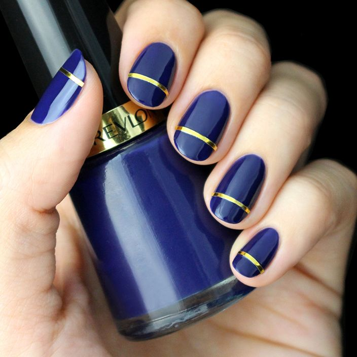 This runway-inspired and celeb-favored gold striped mani holds the perfect touch of glam balanced by a cool indigo hue. Find our tutorial on the blog now!.