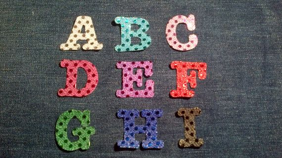 Check out this item in my Etsy shop https://www.etsy.com/listing/214363371/iron-on-fabric-letters-available-in