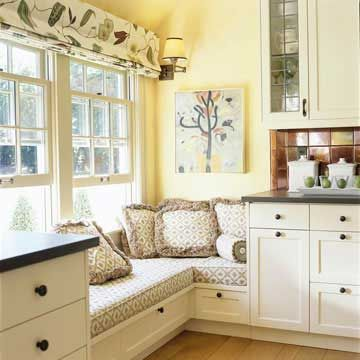 L-Shape Window Seat  Fill a sunny kitchen corner with ample seating for friends or family. A thick cushion and overstuffed pillows add a soft touch and living-room comfort to a hardworking kitchen.