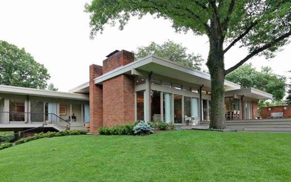 This stunning renovation of a mid century modern home design by Ted Christner in St. Louis MO. The house is amazing with the back section almost cantilevered along a sloping hill.