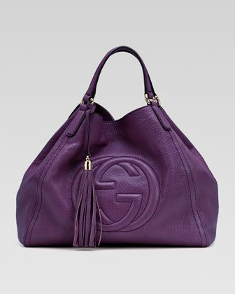 Soho Medium Shoulder Bag by Gucci at Bergdorf Goodman.    Gucci  Soho Medium Shoulder Bag    Choose purple, black, or white leather.  Light golden hardware.  Double shoulder straps; 7″ drop.  Hanging tassel.  Center interlocking G detail.  Hook closure.  Inside, cotton linen lining, zip, cell phone, and PDA pockets.  11 2/5″H x 13 4/5″W x 6 7/10″D.  Made in Italy.    $1,750.00Jingjing Dong