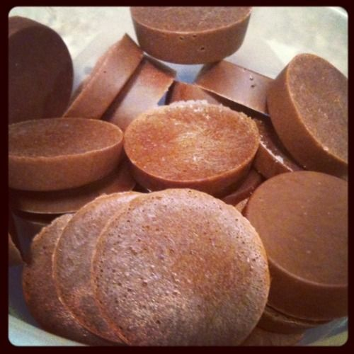 PROTEIN PEANUT BUTTER CUPS  -1 scoop chocolate whey protein powder    -1 TBSP all-natural peanut butter    -1 TBSP unsweetened cocoa powder    -1-2 packets of Stevia    -4oz water      -Blend all the ingredients together in a blender  -Divide the peanut butter mixture into round muffin tins (USE a SILICONE tray!!!), filling about 3/4 full.  -Place filled muffin tin in freezer and let freeze for about an hour or until firm (Freeze any extra peanut butter cups for up to five days)
