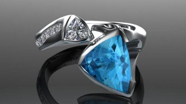 Aquamarine and Diamond set ring in 18ct White Gold
