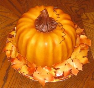 This is pumpkin bundt cake is simple to make.  Prepare two bundt cakes and layer them to achieve the round pumpkin shape, and you have a per...