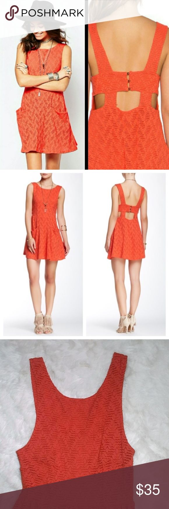 """Free People Lace Poppy Dress in Persimmon Cutout S A cute, sleeveless, fit and flare, skater dress with a unique cut out design. Back three button closure detail and pockets you can actually use! They can comfortably hold your phone or keys. The stretch lace is feminine and fun and the super soft jersey lining is comfortable and easy to wear. Orange  Approximately 33"""" long. Approximately 13.5"""" across the bust, laid flat.  The model is 5'8.5"""" 32-24-34 and is wearing a size S.  Shell: 56%…"""