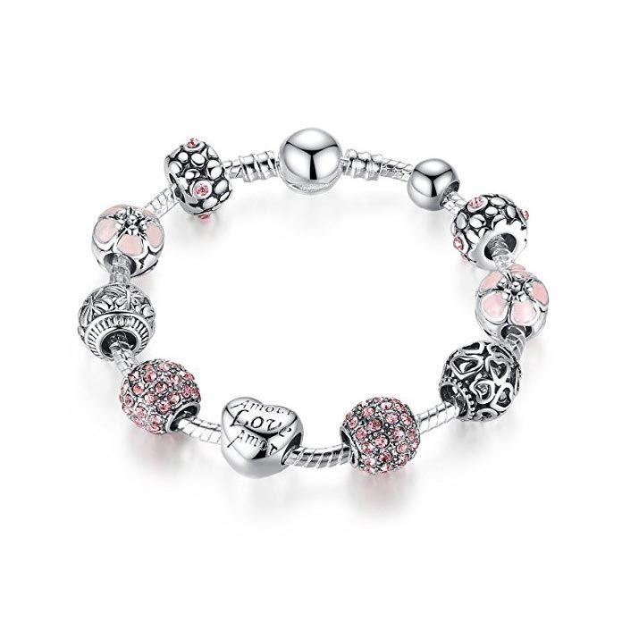Bracciale con ciondoli placcato in oro bianco con cristalli e smalto rosa.