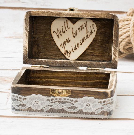 Be my Bridesmaid wooden proposal box - Rustic Personalized box for your Bridesmaid proposal This is a perfect perssonalized box to put your bridesmaids gifts in ! No mather if you have an earrings, bracelet , nacklace or something small and sweet! This will make your proposal even more special and memorable !  Our wooden boxes are hand painted and decorated! This box has a wooden heart with I Thee Wed sign . I also would love to engrave your initials and wed date on a heart inside of the…