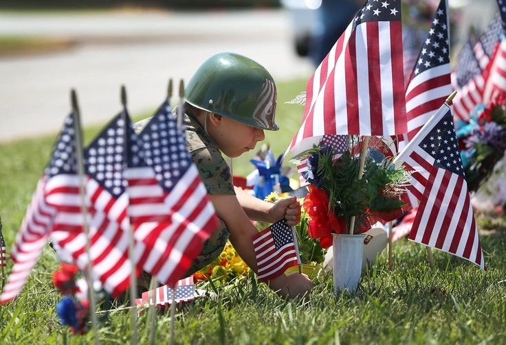 A young boy pays respects to those killed in Tennessee