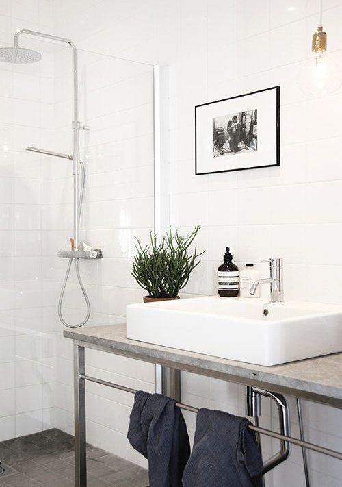 Modern Bathroom with stone/marble sink, galvanized sink legs, and subway tiles