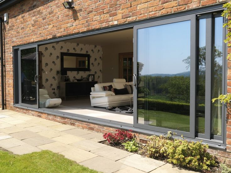 Delamere Cheshire : Installtion of Allstyle Large Sliding Doors, double glazed with celcius Clear self cleaning units. U value 1. Marine finish Polyester Powder coated Alumnium Ral 7012