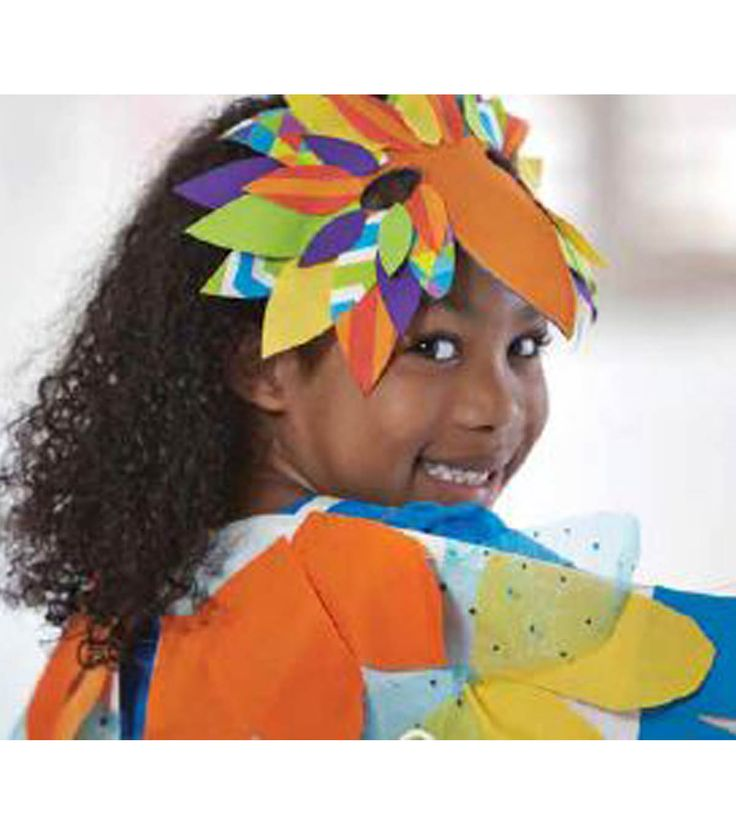 Watch your child's imagination take flight in this bird costume crafted with tropical punch colors!  SUPPLIES & TOOLS:      We Made It by Jennifer Garner Bird Costume Kit     Pencil     Scissors     Iron & pressing surface     Sewing machine (optional)     Basic sewing supplies (optional)