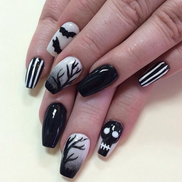 Black and white themed Halloween nail art technique. Play around with smoky tree silhouettes, black skeleton faces, bats and stripes on your nails. You can also use black matte polish for variety on your nails.