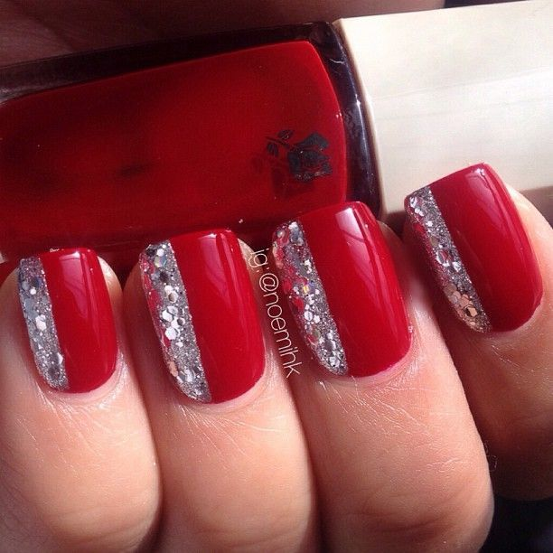 Red nail polish and glitter
