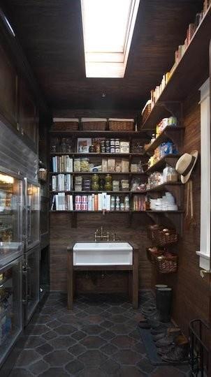 This European-style working pantry elevates storage to an artform. Glass refrigerator doors