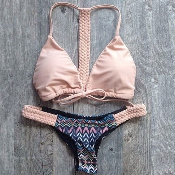 NWT The Aztec Bikini NWT Get ready for summer with this cute pink Aztec bikini! Top ties in the front and has cool braided design down the back. Same braided details are on each side of the bikini bottoms. This is sold as a set, will not sell pieces separately.   Swimsuit Style: Racerback Cheeky Bikini Cups: Yes, removable Color: Light Pink with Blue, Pink, White, Green Aztec design Material: Polyester & Spandex Design: Aztec and Braided Details Size: Medium  *This is a NWT Retail item. *NO…