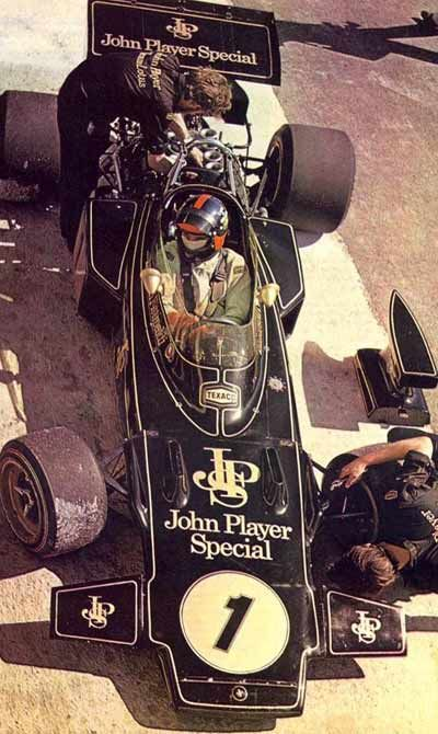 1972 John Player Special Lotus 72 Cosworth Ford F1 Grand Prix Car. That is Emerson Fittipaldi driving possibly my favorite F1 car ever. I was at Watkins Glen in 1971 for the USGP and watched him drive the Red, Gold and White version painted model 72.