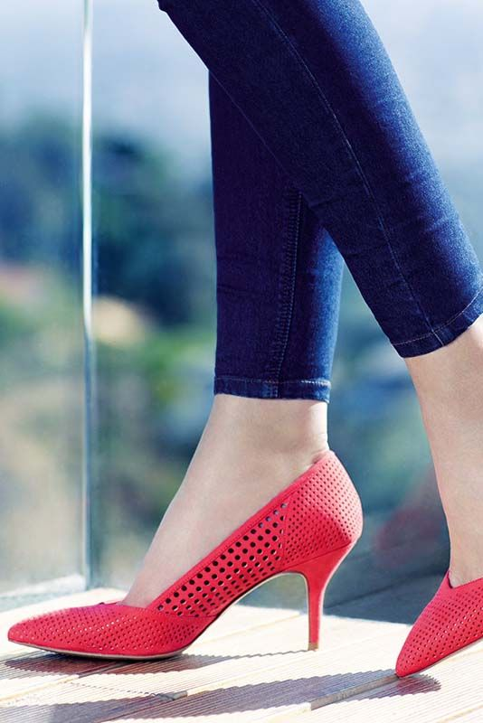 Dress up a pair of jeans in a pair of killer heels -  bright red or hot pink will do the trick.