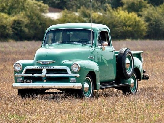 An old, turquoise blue Chevy Pick-up. Yes please
