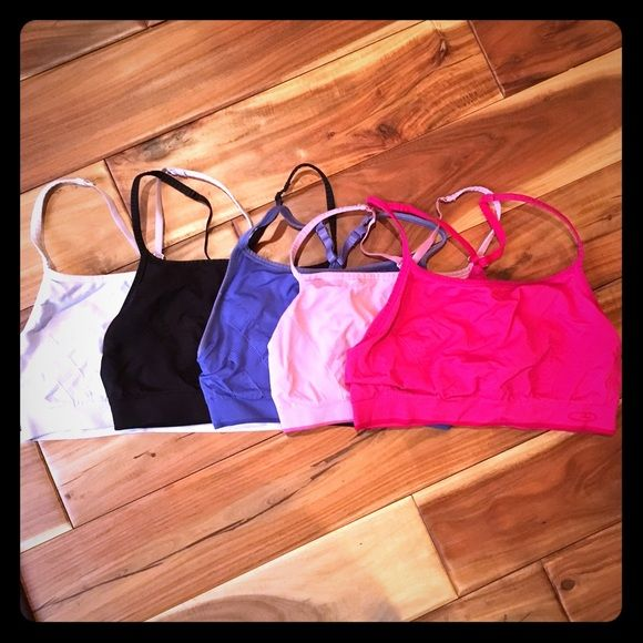 Bundle of 5 champion sports bras size medium Super comfy sports bras from target. They are champion brand. All of them are a size medium. Great condition. The white and black have been worn the most but are still in great condition. Champion Intimates & Sleepwear Bras