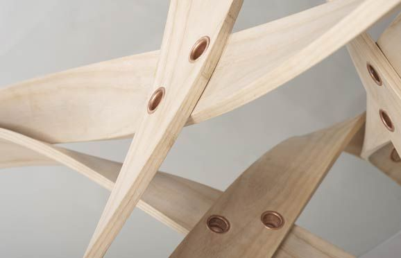 Detail of the XTABLE: a table made in steam bent ash, copper tubular rivets, 10mm thick toughened glass. By David Colwell