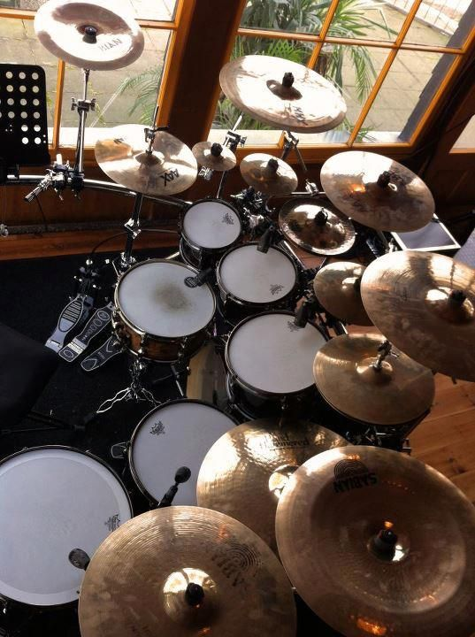 I really like this comfortable home like artistic drum studio setup full of cymbals, snares, toms... You seldom see an aerial view of a 3 pedal drumkit taken with a double set of windows and outdoors view in the background. #DdO:) MOST #POPULAR RE-PINS - http://www.pinterest.com/DianaDeeOsborne/drums-drumming-joy/ - DRUMS AND DRUMMING JOY - One of my favorite drumset photos, and I've seen a lot! Pinned via Dari / dsolis. Lot of percussion pieces in picture, too! fbcdn-s photos link broken.