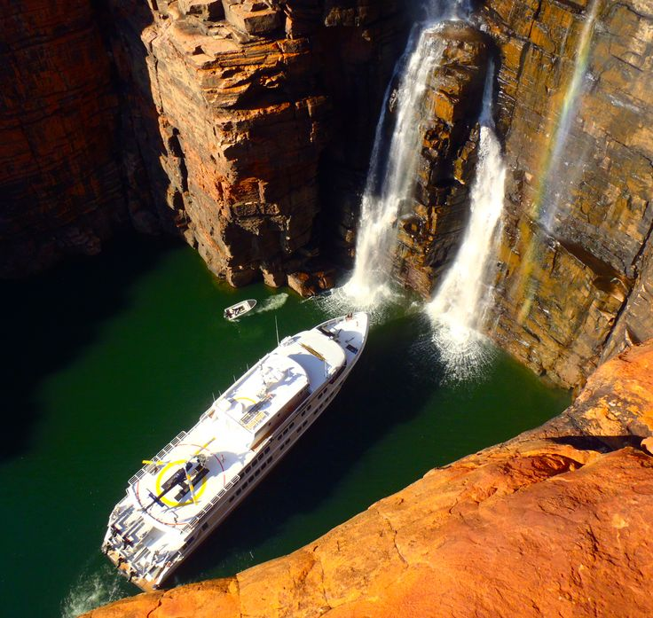 TRUE NORTH. a helicopter. a waterfall... The Kimberley Coast!  #thekimberley #waterfalls #waterfall #helicopter #helicopters #luxurytravel #adventurecruises #adventure #kimberleycruises