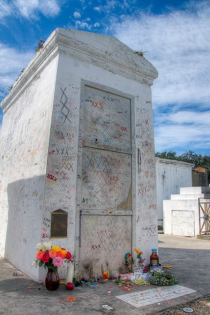 """XXX"" Marie Laveau Crypt I went there .We made 3 xxx turned around twice, left gifts of tobacco and $$$ ."
