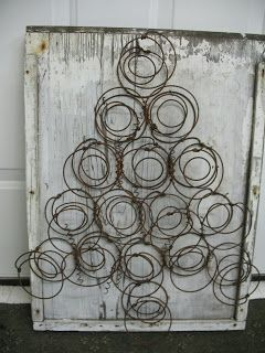 DIY:  Bed Spring Christmas Tree - easy project, using rusty springs,  stapled to a piece of salvaged wood.