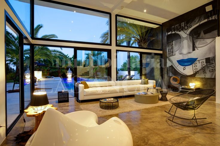 The double height, glass walls of this living room allow lots of natural light into the living area and one can enjoy the beatiful views. Ref.920
