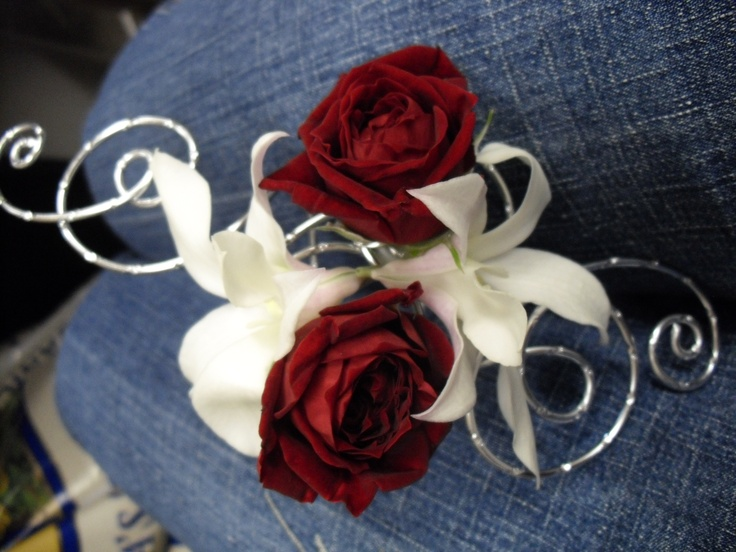 Red and white flower corsage for wedding and prom.
