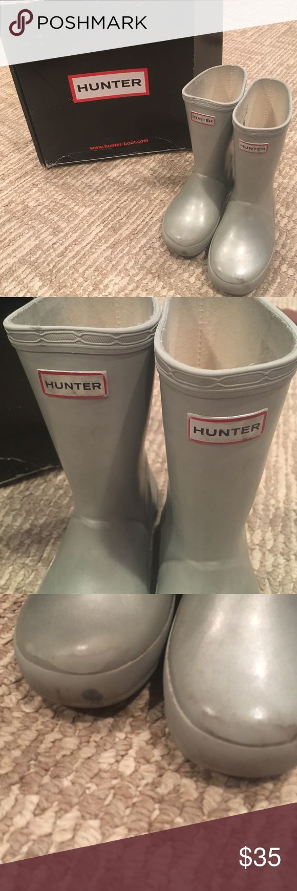 KIDS HUNTER BOOTS SILVER GREY METALLIC COLOR Pre loved kids first metallic silver grey hunter boots. Have some minor scudding as shown in photo - Price reflects flaws. Box shows it's U.K. Size 10 - USA size 12 girl  or size 11 boy! have been worn but are still in good condition- no holes or rips . Follow for deals bundle for discounts Hunter Boots Shoes Rain & Snow Boots