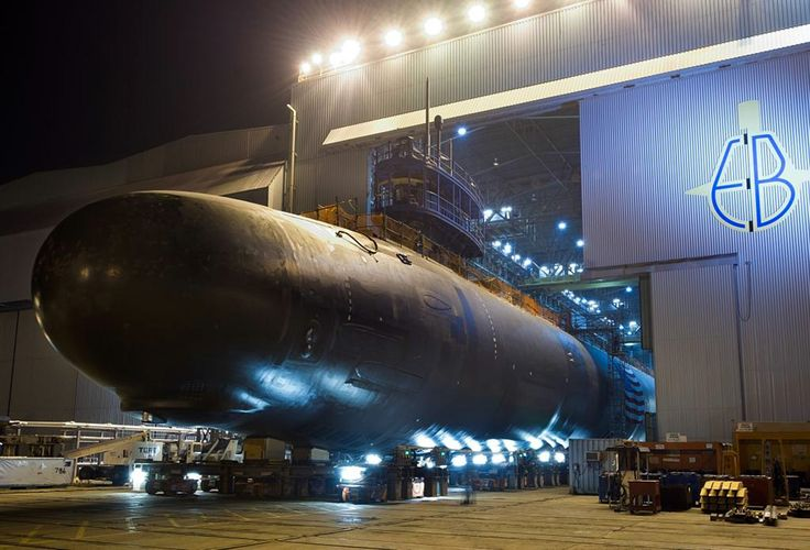 GROTON, Conn. (Sept. 11, 2013) The Virginia-class attack submarine Pre- Commissioning Unit (PCU) North Dakota (SSN 784) is rolled out of an indoor shipyard facility at General Dynamics Electric Boat in Groton, Conn. North Dakota is scheduled to be christened Nov. 2