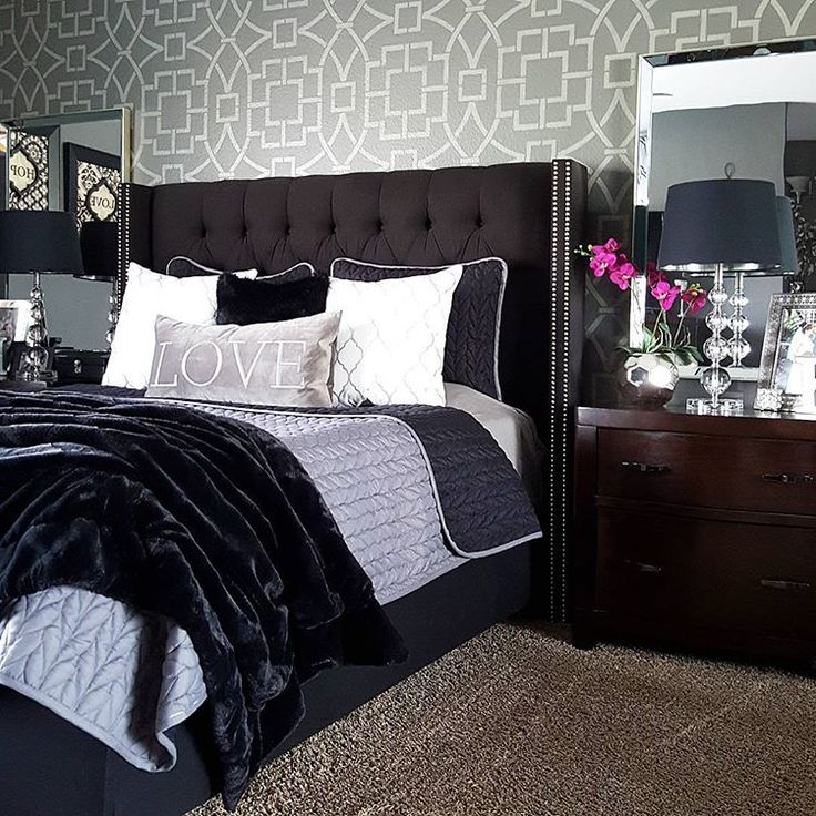 A gray and white stenciled master bedroom accent wall using the Tea House Trellis Stencil, an oversized wall pattern, from Cutting Edge Stencils. http://www.cuttingedgestencils.com/tea-house-trellis-allover-stencil-pattern.html