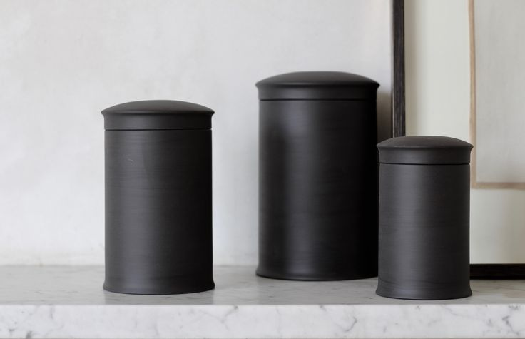 Basalt storage jars which are unglazed on the outside and have a high gloss finish on the inside.