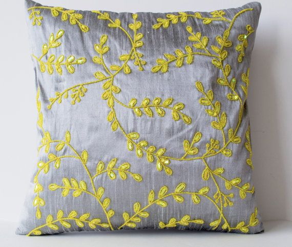 grey yellow throw pillows with beads detail beaded by amorebeaute