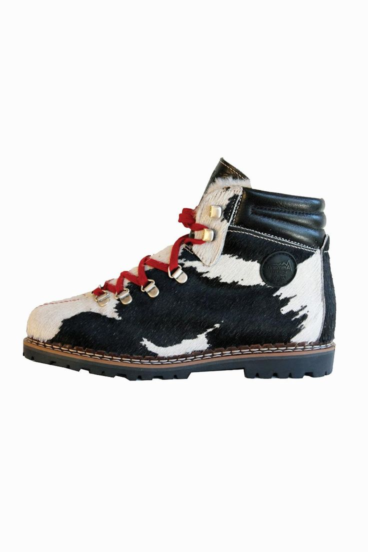 """Classic ankle high boot of black and white fur cowhide with accent red stitching and laces. Tough Vibram sole whose heel measures 3/4"""". Lined in soft lamb fur for warmth and comfort. Beautifully made by this 4th generation family owned Swiss company.  Town Hiker by Ammann. Shoes - Boots - Rain and Cold Weather New York"""