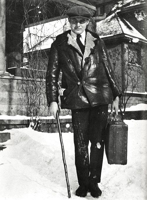 Ernest Hemingway leaving for Toronto, bottle of wine tucked into coatpocket, 1920.