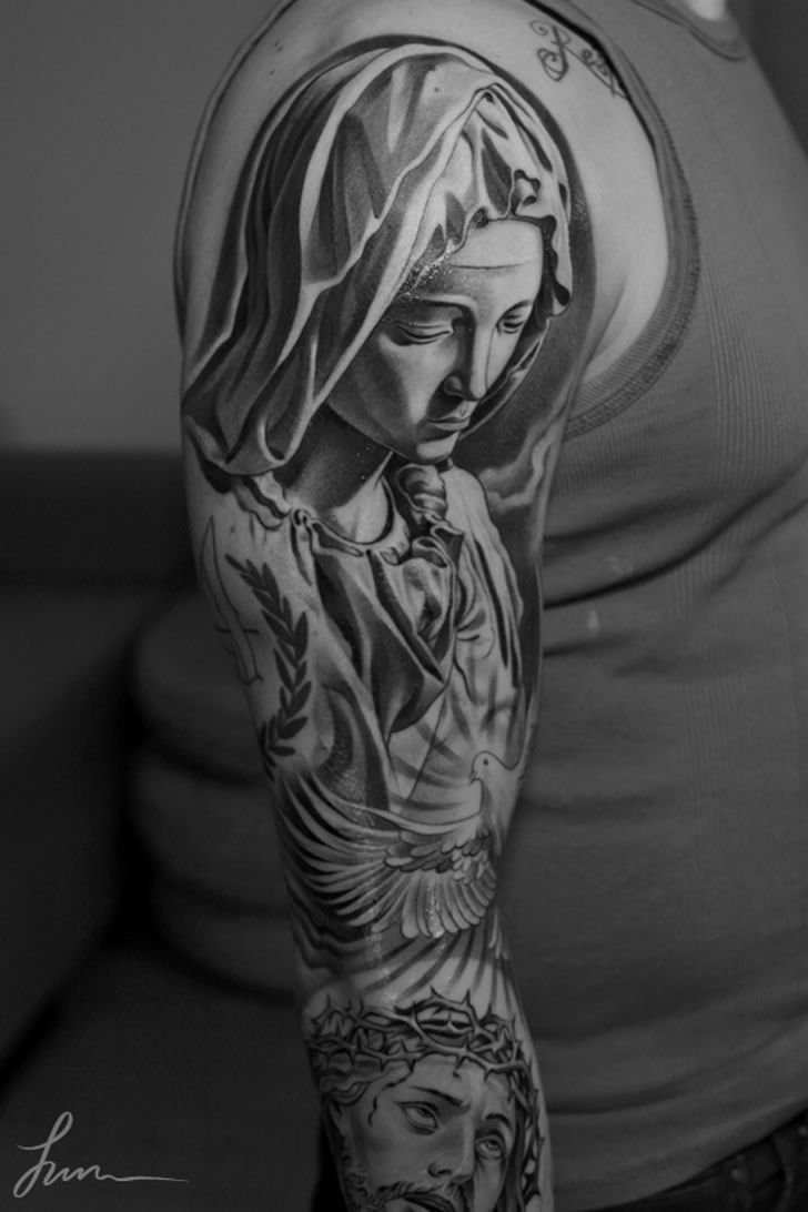 Elegant tattoo by Jun Cha of Mary & Jesus. This tattoo is from Jun Cha's Paris tour.