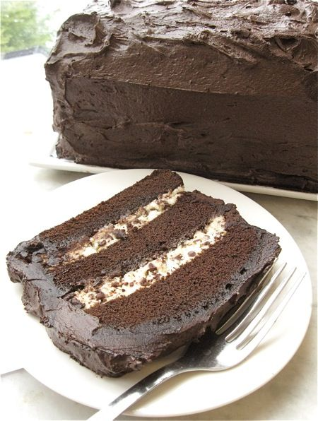 Chocolate Cassata - an American twist on an Italian favorite. This recipe features a dense chocolate cake, filled with sweetened ricotta cheese and chocolate chips, and iced with creamy fudge frosting.